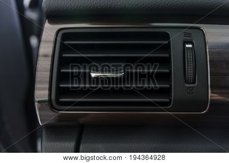 Car air conditioning system grid panel on console. Auto interior detail.