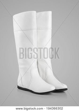 Female White Leather Boots On Gray