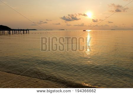 Tranquil scene of beach during sunrise in dawn at Ao Lung Dam beach in Samet island Thailand.