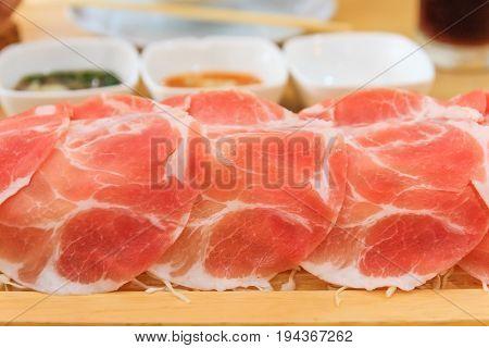 Shabu Shabu or Sukiyaki is a Japanese style and Korean style - Raw pork sliced for hot pot Selective focus