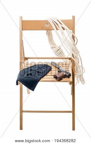 Wooden chair with objects for a hostage on a white background isolated
