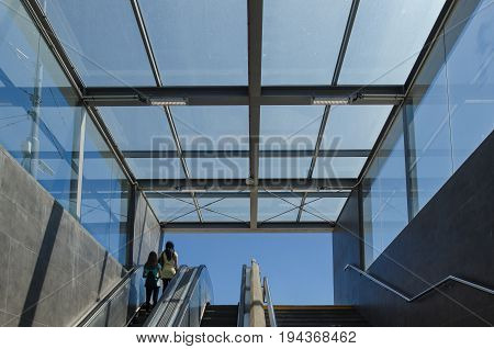 UNDERPASS - Exiting the tunnel and moving stairs into a sunny Poznan day