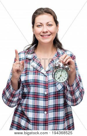 A Woman With An Alarm Clock In Her Hand At 7 O'clock In The Morning