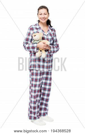 Woman In Pajamas With Teddy Bear On White Background In Full Length