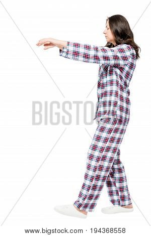 Young Girl Suffering From Sleepwalking In A Dream, Portrait In Full Length On A White Background