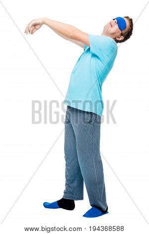 Man Suffers From Sleepwalking, Portrait In Pajamas On White Background