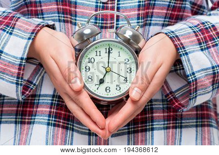 7 Am Shows Alarm Clock In Female Hands