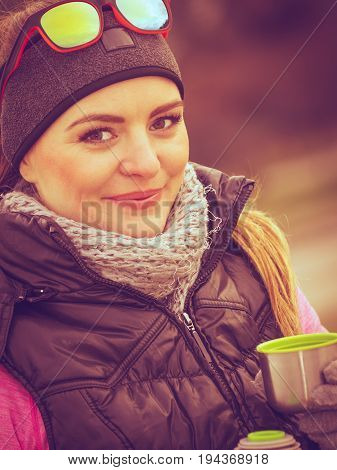Hiker Woman Warming Up Drink Tea In Cold Day