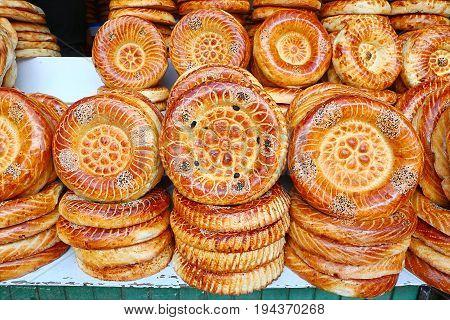 Flat cakes from tandoor on market counter in Bishkek Kyrgyzstan