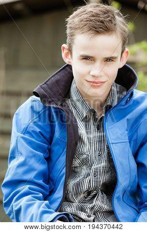 Placid Boy In Bluejacket Smiles At Camera