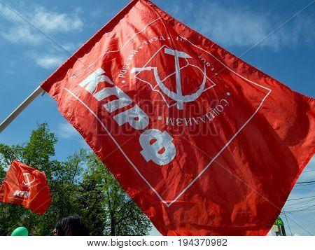 Voronezh, Russia - May 01, 2017: Waving flag of the Communist Party of Russia