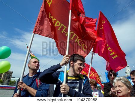 Voronezh, Russia - May 01, 2017: People carry red flags on the May Day demonstration