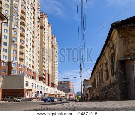 Voronezh, Russia - May 01, 2017: Contrast in architecture: the neighborhood of the old building and the new LCD