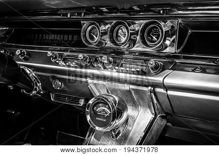 BERLIN - JUNE 17 2017: Fragment of the interior of a full-size car Pontiac Bonneville 1963. Black and white. Classic Days Berlin 2017.