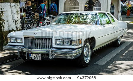 BERLIN - JUNE 17 2017: Full-size luxury car Cadillac Coupe de Ville (fourth generation) 1975. Classic Days Berlin 2017.