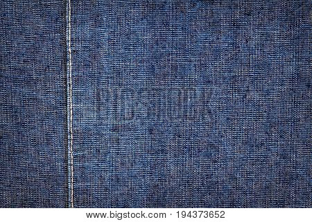 Dark blue jeans texture. Denim jeans texture denim jeans background with a seam. Jeans fashion design.