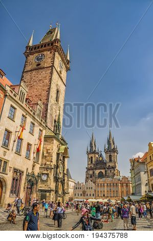 Tourists On Old Town Square. View Towards Old Town Clock Tower, Stare Mesto, Prague