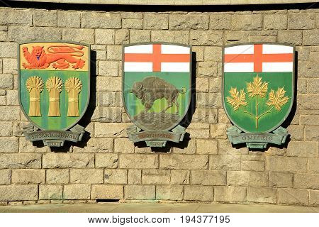 Victoria BC,Canada,August 9th 2014.The coats of arms for the Canadian provinces of Saskatchewan,Manitoba and Ontario hang on a wall in Victoria BC.