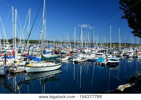 Victoria BC,Canada,August 3rd 2014.Boats of all shapes and sizes docked at the marina in Victoria BC.