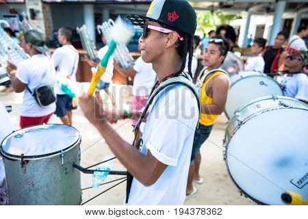 BORACAY, WESTERN VISAYAS, PHILIPPINES - JANUARY 11, 2015: Man moving their arms to play the drums for the Ati-Atihan Festival with his band at White Beach.