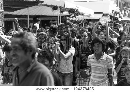 BORACAY, WESTERN VISAYAS, PHILIPPINES - JANUARY 11, 2015: Black and white picture of crowds of natives filipinos of Boracay celebrating Ati-Atihan Festival.