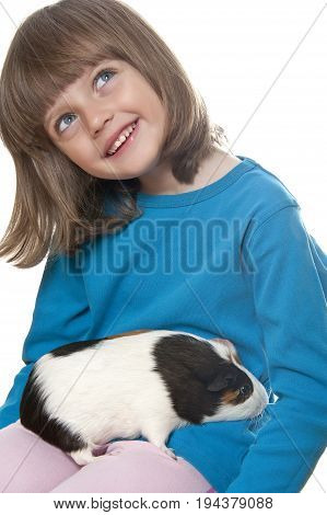 little girl and her pet a guinea pig