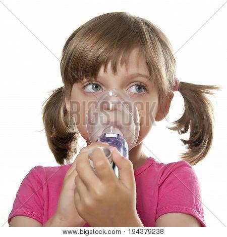 ill little girl using inhaler - respiratory problems