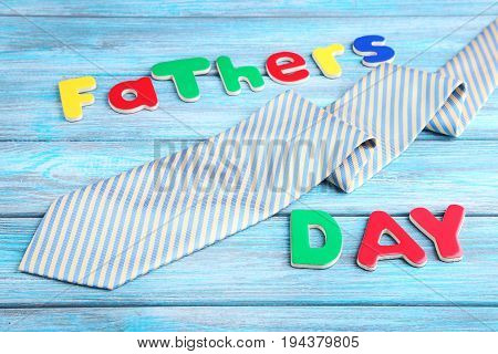 Fathers Day Words With Necktie On Blue Wooden Table
