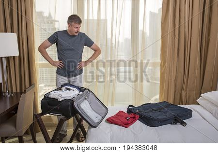 Middle Aged Man Packing A Suitcase