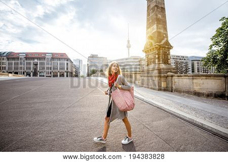 Young woman tourist walking on the Friedrich bridge during the morning in Berlin city