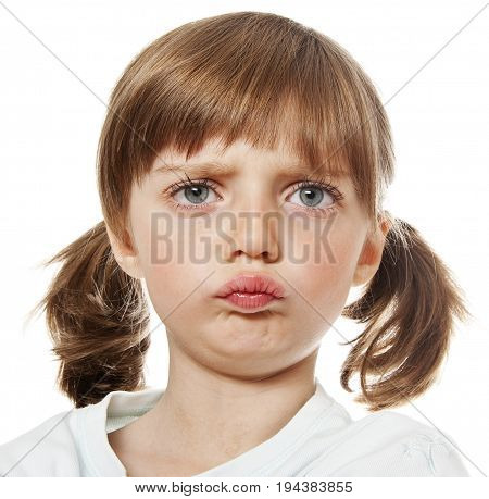 portrait of an angry little girl close up