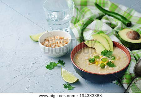 White bean chicken chili on a grey background