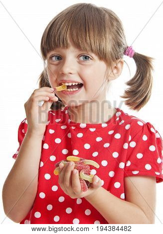 little girl eating gelatine candy close up