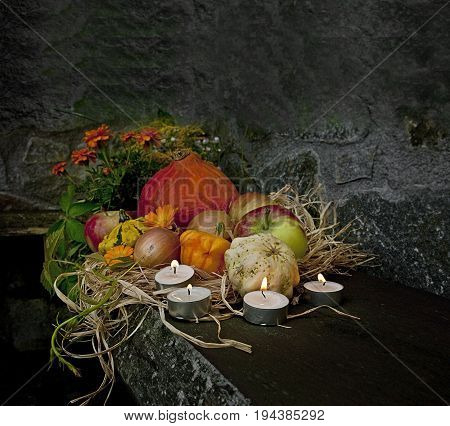 halloween still life with pumpkins and candles in the night time