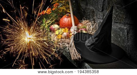 halloween still life with pumpkins and witch hat and broom