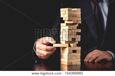 Businessman Building Up Tower Challenge In Business Concept