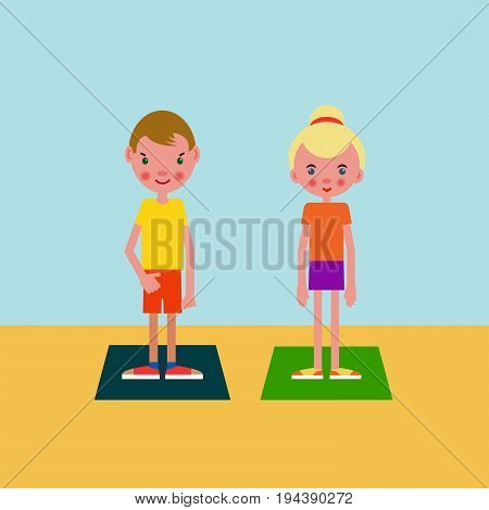 Boy and girl european appearance got ready for the physical exercises and stand on training mats.
