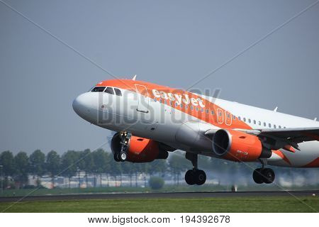 Amsterdam the Netherlands - May 6th 2017: G-EZDA easyJet Airbus A319 takeoff from Polderbaan runway Amsterdam Schiphol Airport