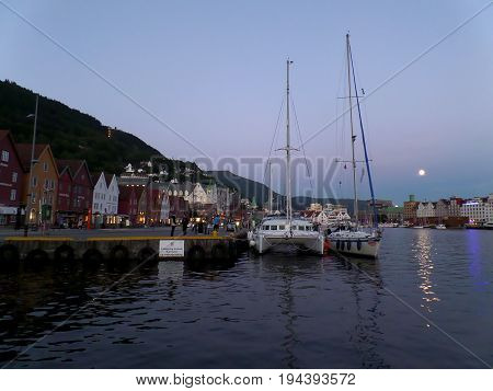 Impressive full moon over Bryggen, the famous historic harbor of Bergen, Hordaland county, Norway
