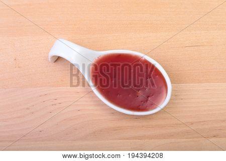 Homemade Organic Red Cranberry Sauce in ceramic saucepan.
