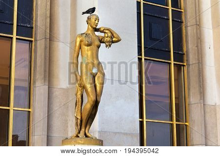 Gilded statue of a naked woman on the Place du Trocadero in Paris France.