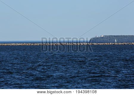 Thunder Bay on Lake Superior with a breakwater and a lighthouse in the distance.