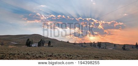 Sunbeams And Sunrays Through Sunset Clouds In The Hayden Valley In Yellowstone National Park In Wyom
