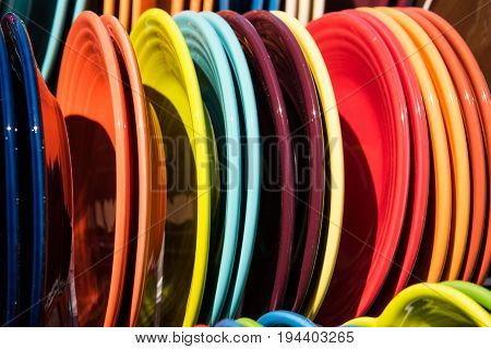 Colorful dinner plates at an outdoor flea market