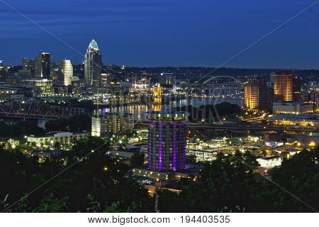 The Cincinnati, Ohio and covington, Kentucky skylines along the waterfront of the Ohio River