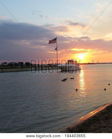 Beautiful summer sunset at City Beach in New Buffalo, Michigan with boats