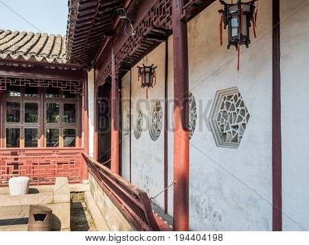 Suzhou, China - Nov 5, 2016: Master of Nets Garden (Wang Shi Yuan) - Pathway designed in the classical Chinese architectural style.