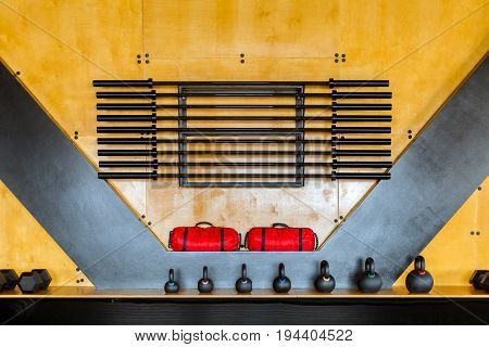 Sports rig for storing barbell without weight weights sports bags near the wall in the gym