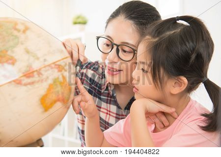 Pretty Homeschooling Mother Teaching Daughter