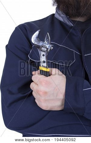 Male hand holding an adjustable wrench on white background